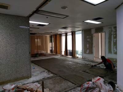 peninggian level lantai kantor wisma indocement jakarta